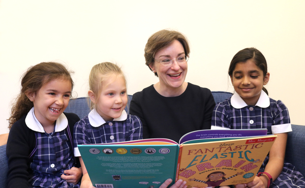 Miss Musgrove with girls reading and laughing